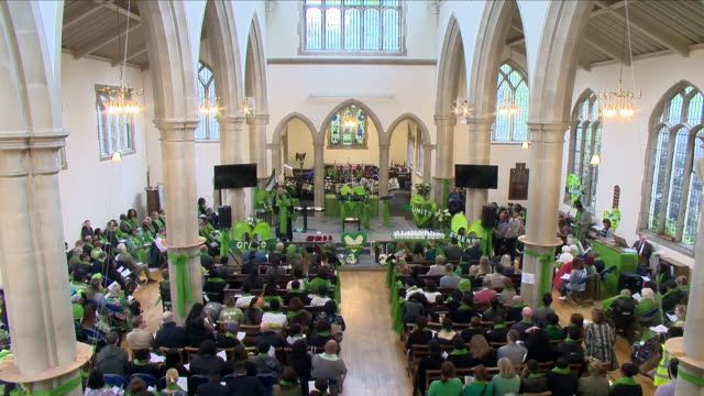 interior shots of the congregation seated during a memorial service to mark the one year anniversary of the grenfell tower fire which killed 72... - トリビュート・イベント点の映像素材/bロール