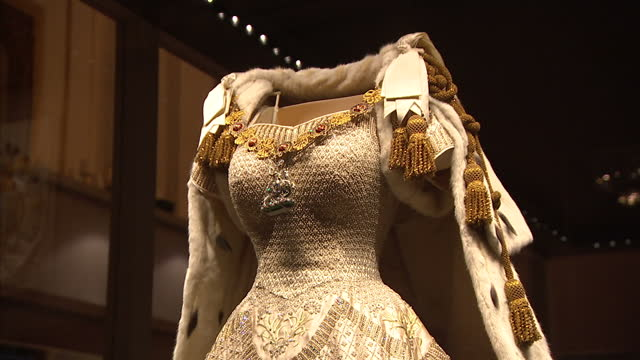 interior shots of the coronation dress and robe worn by queen elizabeth ii at her coronation in 1953 showing embroidered details incorporating the... - バッキンガム宮殿点の映像素材/bロール