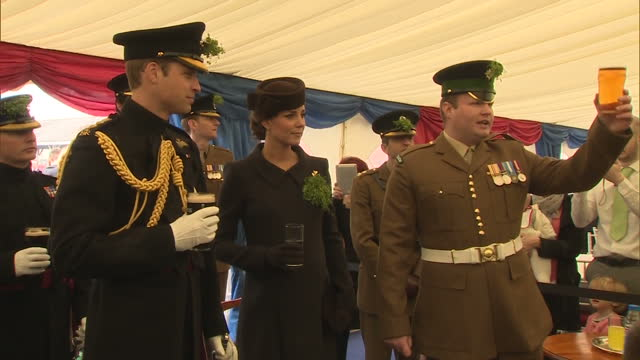 Interior shots of the Duke and Duchess of Cambridge being toasted by members of the 1st Battalion Irish Guards during St Patrick's Day celebrations...