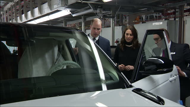 interior shots of the duke and duchess of cambridge meeting staff and apprentices during a visit to jaguar land rover's solihull manufacturing plant... - visit stock videos & royalty-free footage