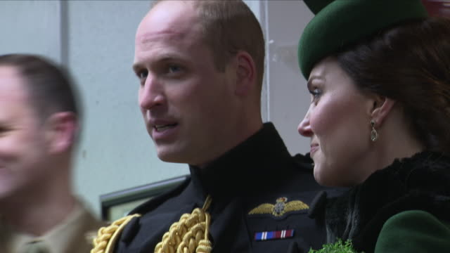 Interior shots of the Duke and Duchess of Cambridge stood chatting to Irish Guards with a pregnant Kate Middleton drinking water and Prince William...