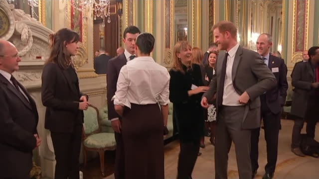 vídeos de stock e filmes b-roll de interior shots of the duke and duchess of sussex greeting and talking to guests at the endeavour fund awards 2019 at goldsmith's hall on 7th february... - duke of sussex