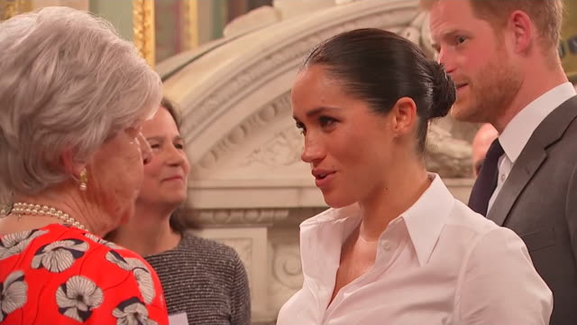vídeos de stock e filmes b-roll de interior shots of the duke and duchess of sussex greeting and talking to a guest at the endeavour fund awards 2019 at goldsmith's hall including the... - duke of sussex