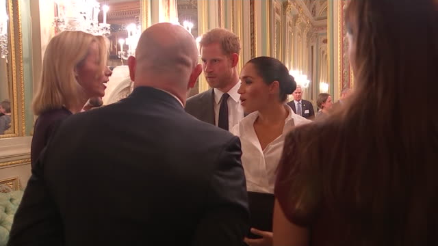 vídeos de stock e filmes b-roll de interior shots of the duke and duchess of sussex greeting and talking to ross kemp at the endeavour fund awards 2019 at goldsmith's hall on 7th... - duke of sussex