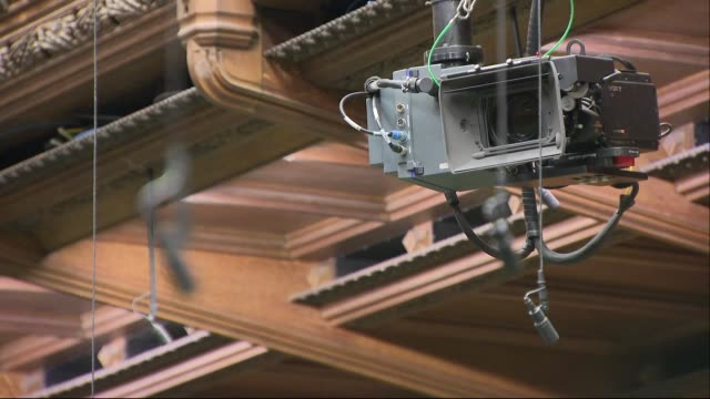 stockvideo's en b-roll-footage met interior shots of the empty house of commons chamber focusing on broadcast tv cameras and microphones on 26 february 2019 in london united kingdom - house of commons