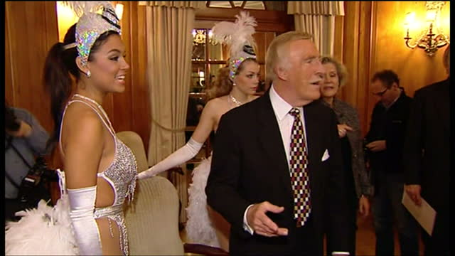 interior shots of the entertainer bruce forsyth sat with two women in the dorchester hotel posing for press photos during his 80th birthday... - dorchester hotel stock videos & royalty-free footage