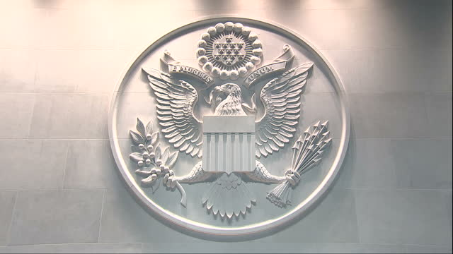 Interior shots of the entrance lobby of the new US embassy building including views of the Great Seal of the United States and names of US...