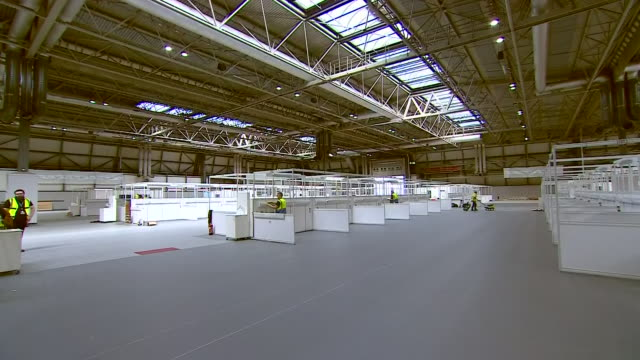 interior shots of the inside of the exhibition halls of the nec with staff working to transform them into wards as it is re-purposed as a nhs... - nightingale stock videos & royalty-free footage