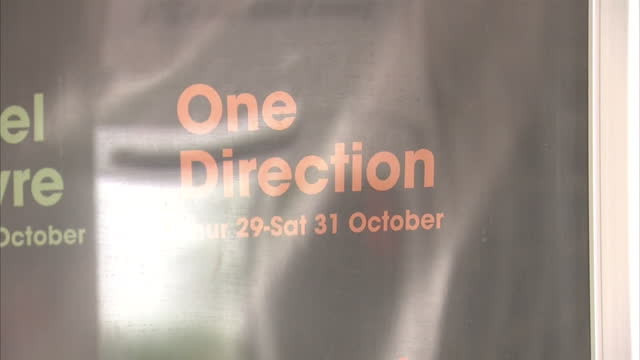 interior shots of the lobby area of the sheffield arena with posters advertising a one direction concert on august 24, 2015 in sheffield, england. - one way stock videos & royalty-free footage