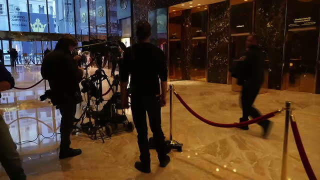 Interior shots of the lobby area of Trump Tower with metal detectors and security and a number of media stood around on January 16 2017 in New York NY