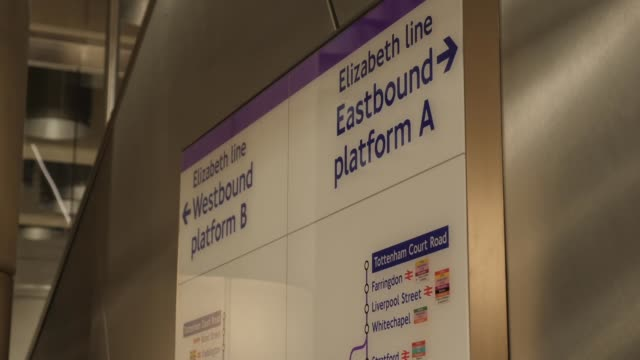 interior shots of the new empty uniopened crossrail tottenham court road station with signs to the platforms on 26 april 2019 in london united kingdom - クロスレール路線点の映像素材/bロール