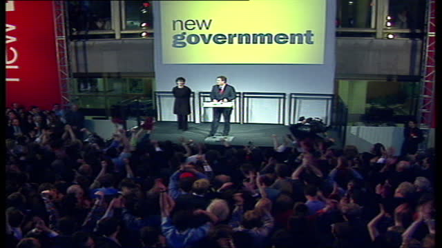 interior shots of the new prime minister tony blair walks onto the stage with his wife cherie blair to make a victory speech after winning the... - british labour party stock videos & royalty-free footage