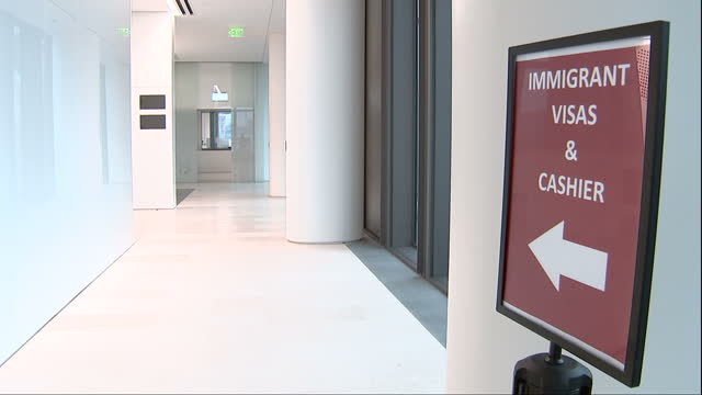 Interior shots of the new US embassy building in London including Visa service desks and signage and a quote by President Robert F Kennedy inscribed...