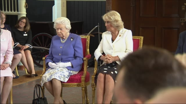 vídeos de stock, filmes e b-roll de interior shots of the queen and camilla duchess of cornwall watching a demonstration of medical detection dogs at a charity event on 6 june 2018 in... - 2018