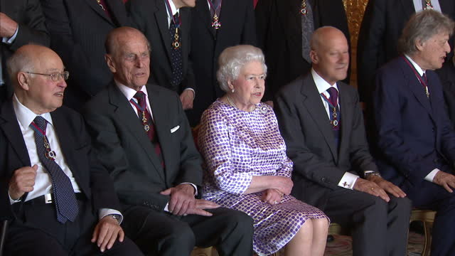 interior shots of the queen and duke of edinburgh meeting guests at the order of merit reception at windsor castle including sir david attenborough,... - scriptwriter stock videos & royalty-free footage