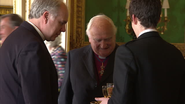 interior shots of the queen and duke of edinburgh meeting guests at the order of merit reception at windsor castle including sir david attenborough,... - baroness stock videos & royalty-free footage