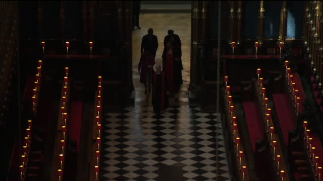 interior shots of the queen and prince charles walking into westminster abbey during a visit to officially open the queen's diamond jubilee galleries... - giubileo di diamante video stock e b–roll