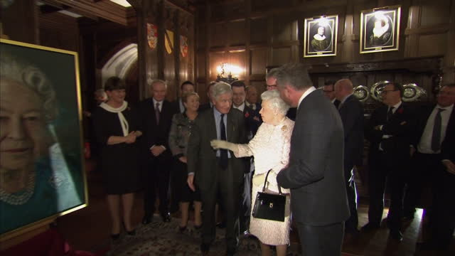 Interior shots of the Queen and Prince Philip Duke of Edinburgh unveiling a portrait of herself painted by Colin Donaldson and accompanied by Irish...