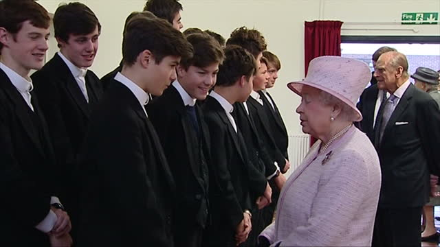 Interior shots of the Queen and Prince Philip meeting a group of students from Eton College which sponsors and shares some facilities with Holyport...