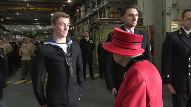 interior shots of the queen arriving and talking with senior officers and crew members of hms queen elizabeth, on 22 may 2021, united kingdom - イングランド南東部点の映像素材/bロール
