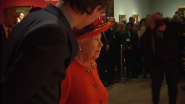 vídeos de stock, filmes e b-roll de interior shots of the queen being shown around and viewing the 'charles i king and collector' collection at the royal academy of arts on 20th march... - royal academy of arts