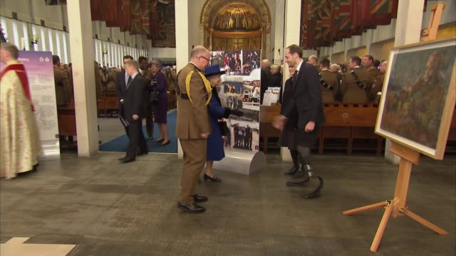 interior shots of the queen inspecting paintings by harry parker after a service to commemorate the centenary of the royal army chaplains' department... - gottesdienst stock-videos und b-roll-filmmaterial