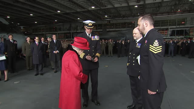 interior shots of the queen meeting and speaking with senior officers and crew members of hms queen elizabeth, on 22 may 2021, united kingdom - イングランド南東部点の映像素材/bロール