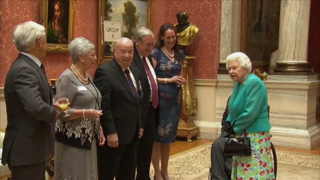 Interior shots of The Queen meeting various recepients of the George Cross and Victoria Cross at a special reception at Buckingham Palace on 16 May...