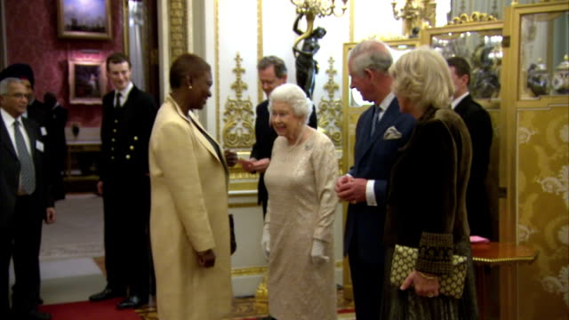 Interior shots of the Queen Prince Charles and Camilla Duchess of Cornwall greeting guests at a reception for the Commonwealth Diaspora at Buckingham...