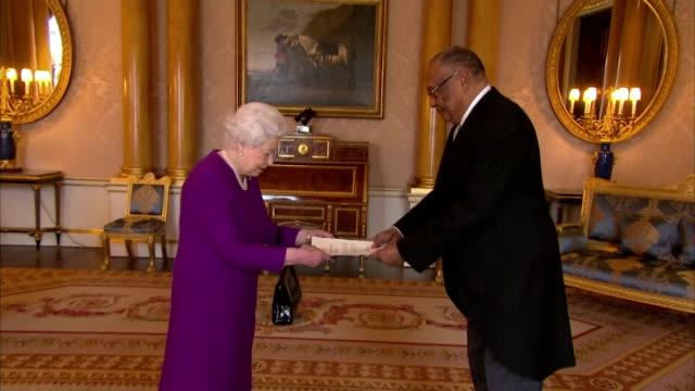 vídeos de stock, filmes e b-roll de interior shots of the queen receiving francis blain the new high commissioner for the republic of the gambia at buckingham palace >> on february 09... - 2018