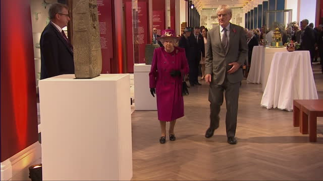 Interior shots of the Queen touring the Sir Joseph Hotung Gallery of China and South Asia at the British Museum and viewing various exhibits on...