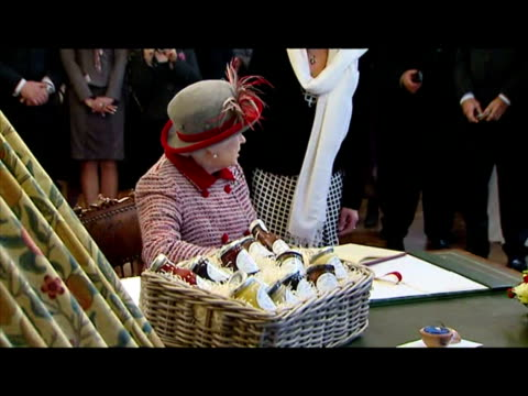 stockvideo's en b-roll-footage met interior shots of the queen touring the tea rooms at tiptree jam factory and unveiling plaque queen visits tiptree jam factory in essex on october 28... - meer dan 50 seconden