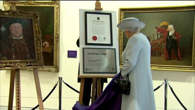 interior shots of the queen unveiling a commemorative plaque during a visit to the royal college of physicians to mark its 500th anniversary>> on... - plaques stock videos & royalty-free footage