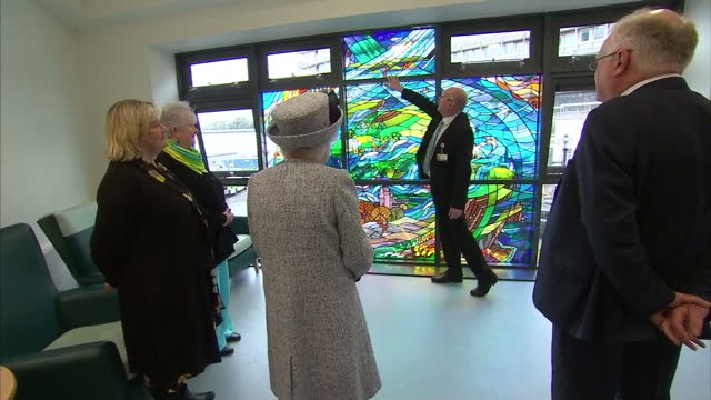 vídeos de stock, filmes e b-roll de interior shots of the queen visiting aberdeen royal infirmary and viewing a stained glass window with details representing local landmarks industry... - 2017