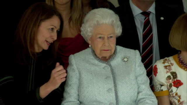 interior shots of the queen watching a runway show during a visit to london fashion week sitting between professor caroline rush chief executive of... - königin elisabeth ii. von england stock-videos und b-roll-filmmaterial