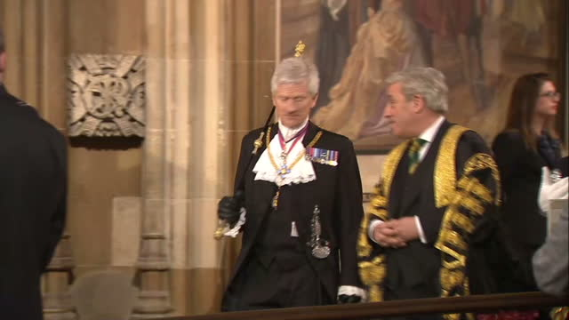interior shots of the sergeant at arms and black rod leading british members of parliament including prime minister david cameron and leader of the... - the queen's speech state opening of uk parliament stock videos & royalty-free footage