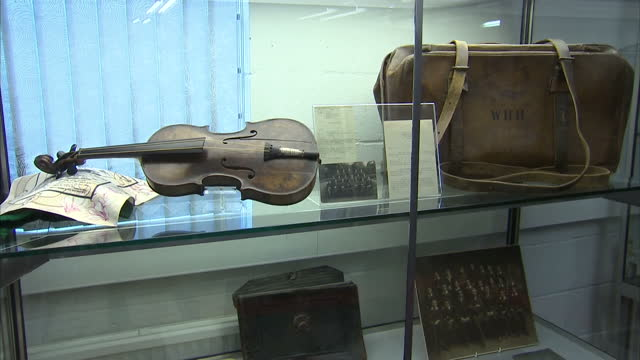 interior shots of the titanic violin on display in glass cabinet at wiltshire auction. titanic violin on display at wiltshire auction on october 18,... - wiltshire stock videos & royalty-free footage