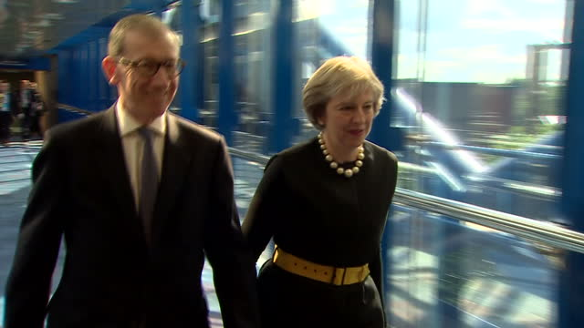 interior shots of theresa may mp and husband philip may walking at the conservative party conference on october 02 2016 in birmingham england - husband stock videos & royalty-free footage