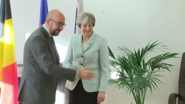 Interior shots of Theresa May posing briefly shaking hands with Belgian Prime Minister Charles Michel before sitting down for a bilateral meeting on...
