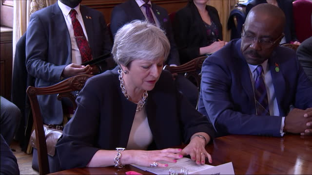 interior shots of theresa may prime minister discussing the windrush generation immigration at meeting at caribbean heads of state on 17 april 2018... - government minister stock videos & royalty-free footage
