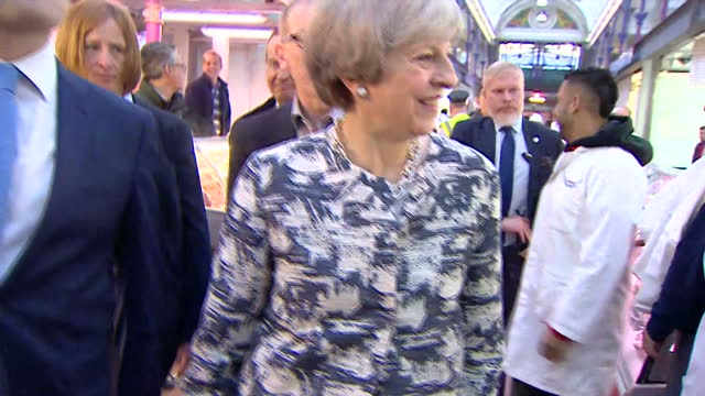 interior shots of theresa may speaking to butchers during a visit to smithfield market, accompanied by her husband philip, on the last day of... - last day stock videos & royalty-free footage
