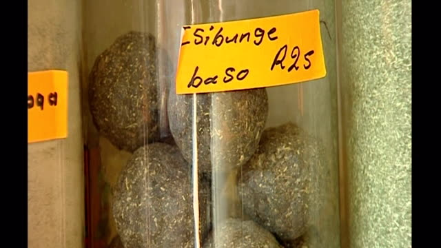 stockvideo's en b-roll-footage met interior shots of traditional folk medicines in jars and on shelves in muti medicine shop on october 23 2006 in johannesburg south africa - gauteng provincie