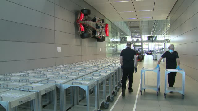 vídeos y material grabado en eventos de stock de interior shots of trollies to be used to house new ventilators for the nhs in the fight against coronavirus in mclaren's headquarters, with several... - equipo respiratorio
