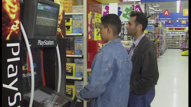 vídeos de stock e filmes b-roll de interior shots of two teenage boys playing a video game at a display for the playstation on september 27 1995 in london england - sony