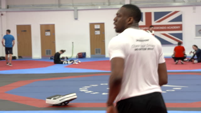 interior shots of twotime olympic medallist and taekwando athlete lutalo muhammad sparring and on an exercise bike on 19th march 2020 in manchester... - medallist stock videos & royalty-free footage