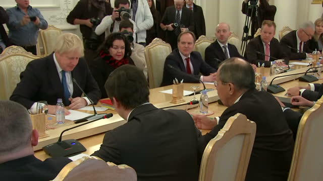 Interior shots of UK Foreign Secretary Boris Johnson listening as his Russian counterpart Sergei Lavrov speaks during the start of a bilateral...