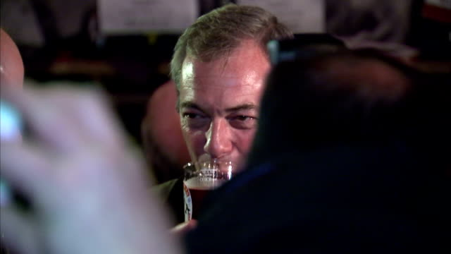 interior shots of ukip leader nigel farage drinking a pint at a local beer festival on april 04 2015 in margate england - british liberal democratic party stock videos & royalty-free footage