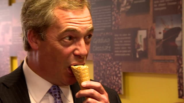 Interior shots of UKIP LEader Nigel Farage talking to supporters in an Ice Cream parlour whilst eating an icecream on April 08 2015 in Skegness...
