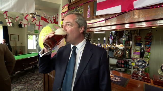 interior shots of ukip leader nigel farage toasting the birth of the royal baby with a pint of beer in a pub in ramsgate holding an 'it's a girl'... - it's a girl stock videos & royalty-free footage
