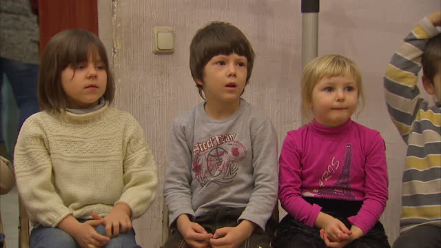 interior shots of ukrainian children kids in the way home charity interior shots of children singing playing in charity abode on january 21 2015 in... - ukraine stock-videos und b-roll-filmmaterial